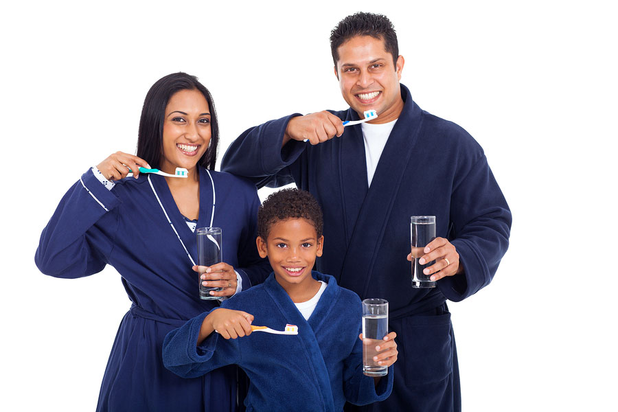 Family_Brushing_Their_Teeth_BigStock_46807495
