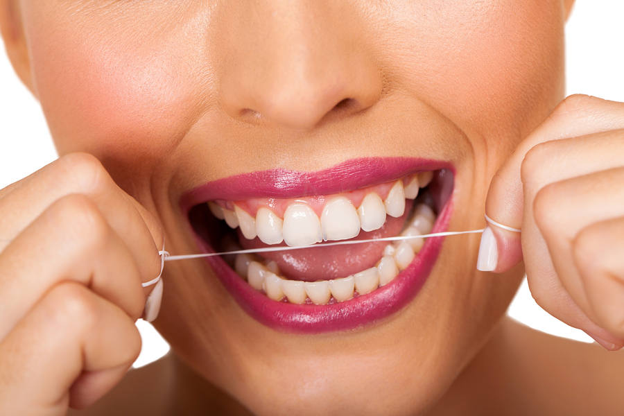 oral hygiene woman cleaning teeth with floss