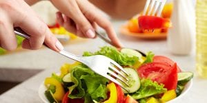 Woman eating a healthy salad with a fork