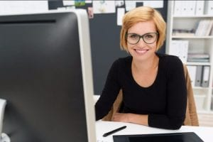 smiling woman using computer