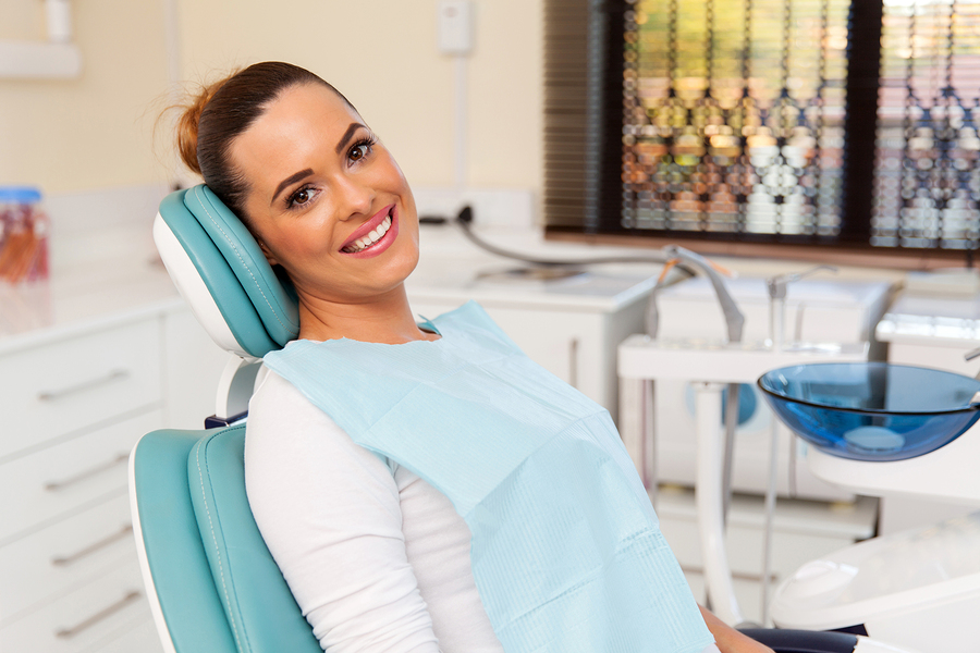 Woman in dental chair for cosmetic dentistry