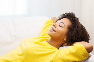 happy african young woman relaxing at home